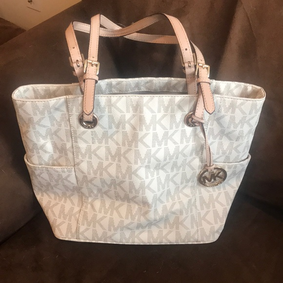 Michael Kors Bags   Cream Colored Mk Purse With Tan Straps   Poshmark 2ef053ad2a